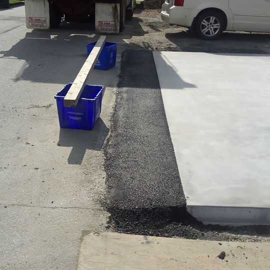 Paving ramp to city road after concrete driveway